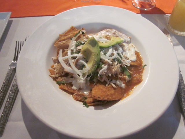 And now for the main event!  Chilaquiles, crispy tortilla chips smothered in red sauce, crema, red onions, and chicken