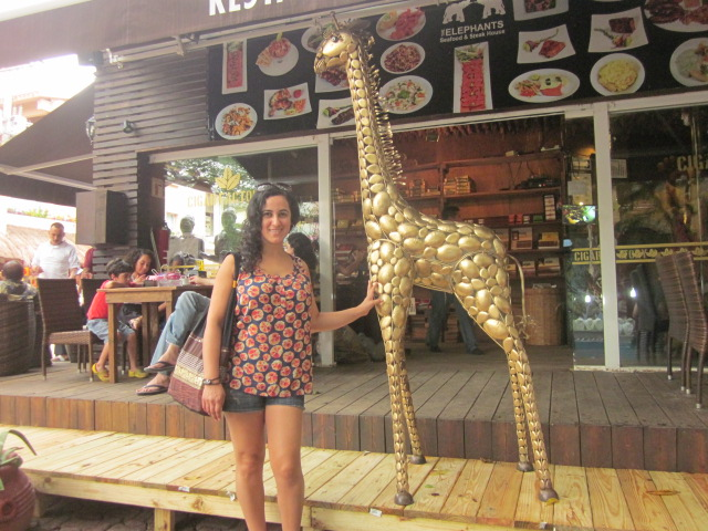 First, Beata made new friends with a giraffe down the street...