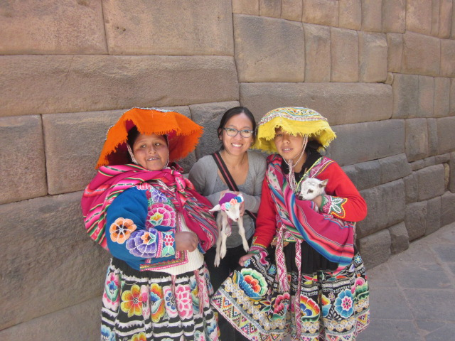These Cusquena women look sweet but man are they aggressive!  I got cornered into taking a pic with them and their little sheep (see, how can you say no) and promptly got charged for it