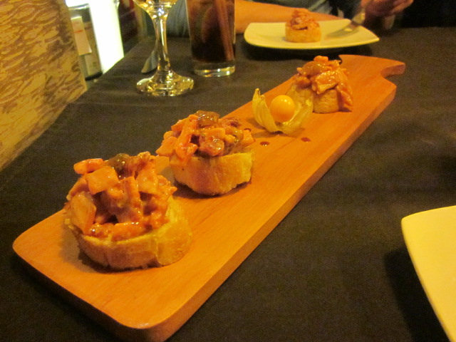 Amazing (and creative!) bruschetta from Uchu: made with caramelized tomatoes, smoked bacon, tamarind, and aguaymanto (a local Peruvian berry)