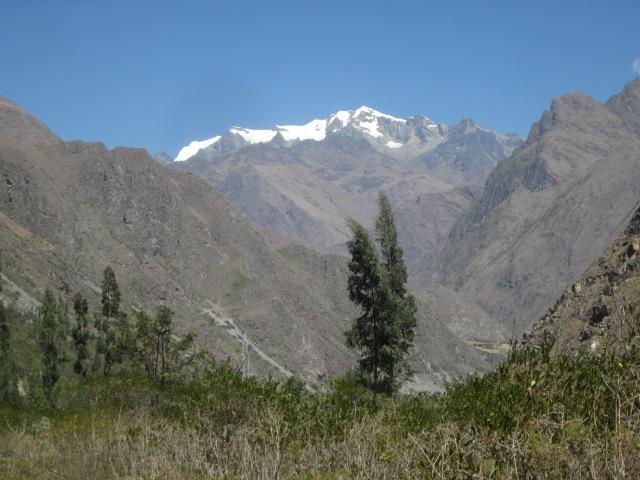 Morning trek alongside snow-capped mountains