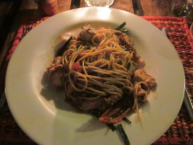 Tallarin de saltado de pollo - chicken stir-fried with pasta, tomatoes, and onions in a soy sauce
