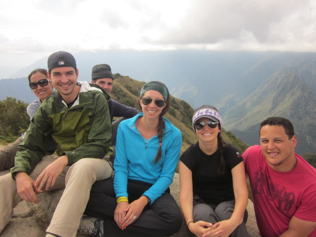 Taking a breather with our gang at the third summit.  We were literally above the clouds!