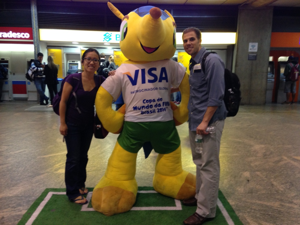 Posing with Fuleco, the 2014 World Cup mascot.  The armadillo was chosen both because it's native to Brazil and because of its resemblance to a ball when it rolls up.