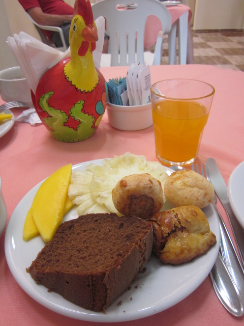 Breakfast of homemade cake, pao de queijo (of course), and some fresh tropical fruits