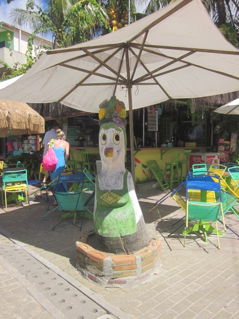 "Funny wooden chickens in all sorts of ""outfits"" strewn all over Porto de Galinhas"