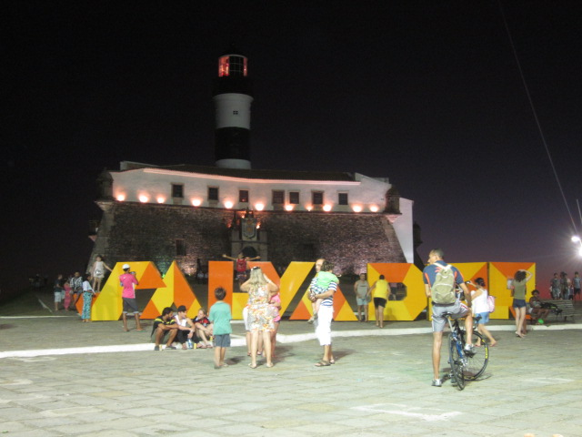 Welcome to Salvador - sign by the lighthouse that mirrors the vibrant and colorful culture of the city