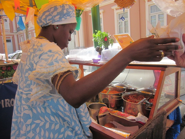 A local Bahian woman preparing acaraje, a well-known local street food