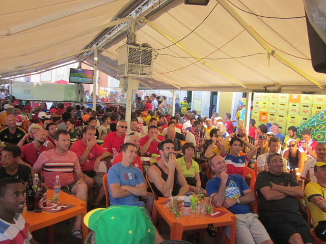 Makeshift outdoor space that doubles as a restaurant extension during the Argentina-Switzerland game