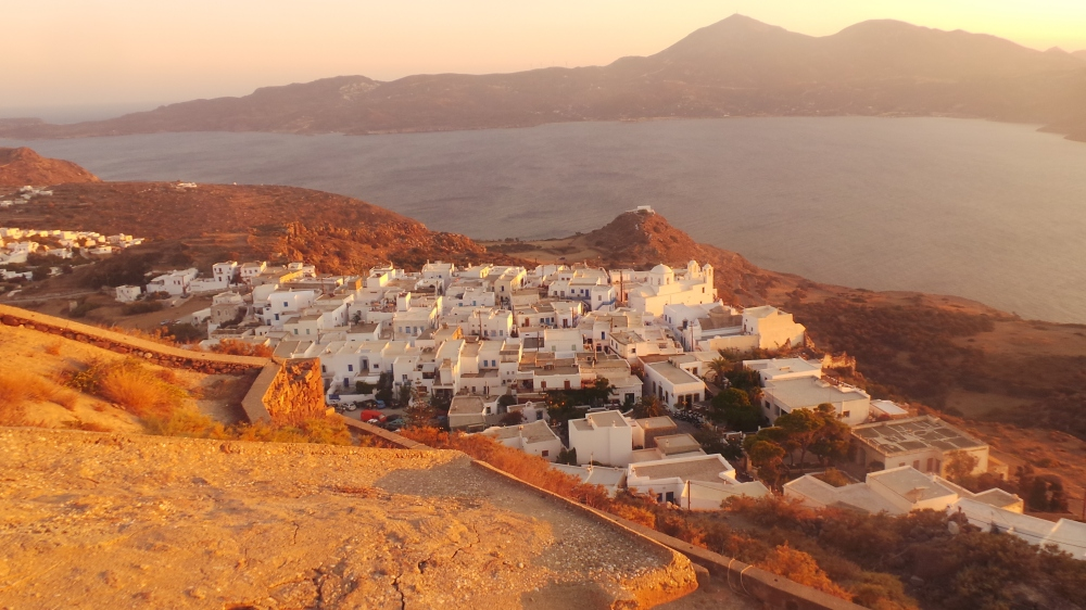 The whitewashed buildings took on amazing hues as the sun set over the island